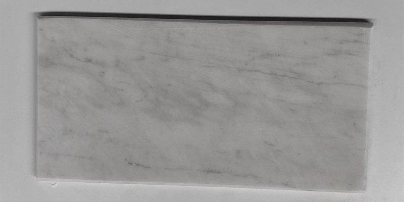 Trang trí phòng khách với đá chà cát xẻ cạnh trắng sữa 10x20cm